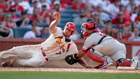 St. Louis Cardinals' Matt Holliday,left, scores from third on a fielder's choice by Jhonny Peralta as Philadelphia Phillies catcher Carlos Ruiz makes the late tag in the eighth inning of a baseball game, Saturday, June 21, 2014, in St. Louis. The Cardinals won 4-1. (AP Photo/Tom Gannam)