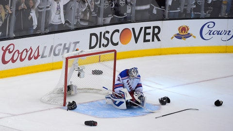 New York Rangers goalie Henrik Lundqvist, of Sweden, reacts after the Los Angeles Kings won 3-2 in double overtime in Game 5 of an NHL hockey Stanley Cup finals, Friday, June 13, 2014, in Los Angeles.  (AP Photo/Mark J. Terrill)