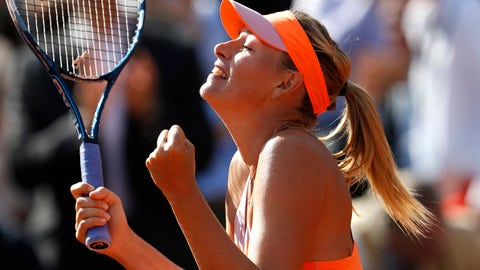 Russia's Maria Sharapova reacts as she defeats Canada's Eugenie Bouchard during their semifinal match of  the French Open tennis tournament at the Roland Garros stadium, in Paris, France, Thursday, June 5, 2014. Sharapova won 4-6, 7-5, 6-2. (AP Photo/Darko Vojinovic)