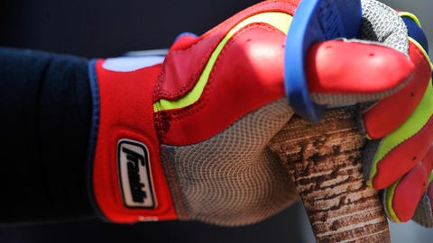May 25, 2014; Baltimore, MD, USA; Detail view of batting glove and bat of Cleveland Indians first baseman Nick Swisher (33) during a game against the Baltimore Orioles at Oriole Park at Camden Yards. The Orioles defeated the Indians 4-2. Mandatory Credit: Joy R. Absalon-USA TODAY Sports