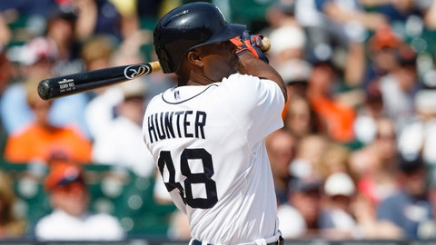 Jun 15, 2014; Detroit, MI, USA; Detroit Tigers right fielder Torii Hunter (48) hits a single in the ninth inning against the Minnesota Twins at Comerica Park. Mandatory Credit: Rick Osentoski-USA TODAY Sports