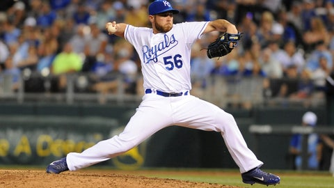 May 21, 2014; Kansas City, MO, USA; Kansas City Royals relief pitcher Greg Holland (56) delivers a pitch in the ninth inning against the Chicago White Sox at Kauffman Stadium. The Royals won 3-1.  Mandatory Credit: Denny Medley-USA TODAY Sports