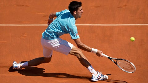 Jun 6, 2014; Paris, France;  Novak Djokovic (SRB)  in action during his match against Ernests Gulbis (LAT) on day 13 at the 2014 French Open at Roland Garros. Mandatory Credit: Susan Mullane-USA TODAY Sports