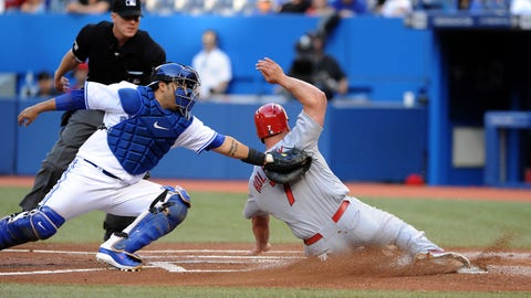 Jun 6, 2014; Toronto, Ontario, CAN; Toronto Blue Jays catcher Dioner Navarro tags out St. Louis Cardinals left fielder Matt Holliday in the first inning at Rogers Centre. Mandatory Credit: Dan Hamilton-USA TODAY Sports
