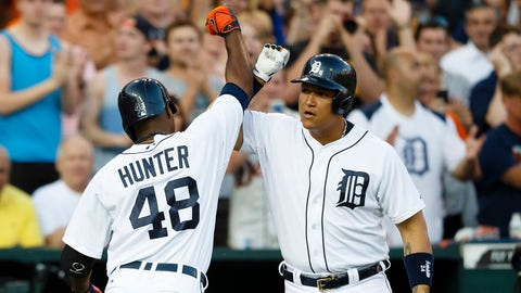 Jun 6, 2014; Detroit, MI, USA; Detroit Tigers right fielder Torii Hunter (48) receives congratulations from first baseman Miguel Cabrera (24) after he hits a home run in the fifth inning against the Boston Red Sox at Comerica Park. Mandatory Credit: Rick Osentoski-USA TODAY Sports