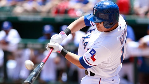 Jun 8, 2014; Arlington, TX, USA; Texas Rangers designated hitter Shin-Soo Choo (17) hits a fly ball in the first inning against the Cleveland Indians at Globe Life Park in Arlington. Mandatory Credit: Tim Heitman-USA TODAY Sports