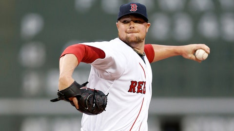 Jun 12, 2014; Boston, MA, USA; Boston Red Sox pitcher Jon Lester (31) delivers a pitch during the first inning against the Cleveland Indians at Fenway Park. Mandatory Credit: Greg M. Cooper-USA TODAY Sports