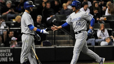 Jun 13, 2014; Chicago, IL, USA; Kansas City Royals second baseman Omar Infante (14) is greeted by left fielder Alex Gordon (4) after scoring against the Chicago White Sox during the seventh inning at U.S Cellular Field. Mandatory Credit: David Banks-USA TODAY Sports