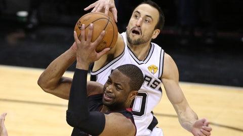 Jun 15, 2014; San Antonio, TX, USA; San Antonio Spurs guard Manu Ginobili (20) defends against Miami Heat guard Dwyane Wade (3) in game five of the 2014 NBA Finals at AT&T Center.Mandatory Credit: Soobum Im-USA TODAY Sports