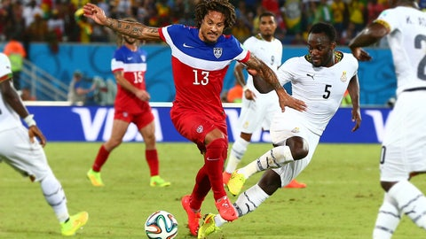Jun 16, 2014; Natal, BRAZIL; USA midfielder Jermaine Jones (13) controls the ball against Ghana midfielder Michael Essien (5) in the second half during the 2014 World Cup at Estadio das Dunas. USA defeated Ghana 2-1. Mandatory Credit: Mark J. Rebilas-USA TODAY Sports