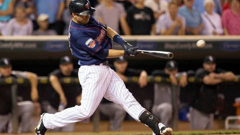 Jun 20, 2014; Minneapolis, MN, USA; Minnesota Twins second baseman Brian Dozier (2) hits a walk off RBI single in the ninth inning against the Chicago White Sox at Target Field. The Twins won 5-4. Mandatory Credit: Jesse Johnson-USA TODAY Sports