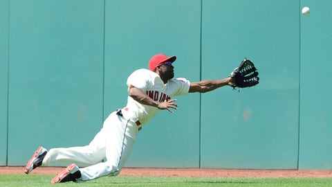 Jun 22, 2014; Cleveland, OH, USA; Cleveland Indians center fielder Michael Bourn (24) makes a diving attempt on a ball hit by Detroit Tigers catcher Alex Avila during the sixth inning at Progressive Field. Mandatory Credit: Ken Blaze-USA TODAY Sports