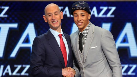 Jun 26, 2014; Brooklyn, NY, USA; Dante Exum (Australia) shakes hands with NBA commissioner Adam Silver after being selected as the number five overall pick to the Utah Jazz in the 2014 NBA Draft at the Barclays Center. Mandatory Credit: Brad Penner-USA TODAY Sports
