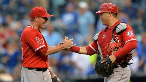 Jun 28, 2014; Kansas City, MO, USA; Los Angeles Angels pitcher Joe Smith (38) celebrates with catcher Hank Conger (16) after beating the Kansas City Royals 6-2 at Kauffman Stadium. Mandatory Credit: Peter G. Aiken-USA TODAY Sports