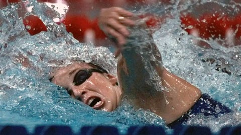 FILE - In this July 24, 1996 file photo, Amy Van Dyken of the United States swims her leg of the women's 4X100 meter medley relay at the 1996 Summer Olympics in Atlanta. Van Dyken has a severed spine after an accident on her all-terrain vehicle in Arizona. A hospital spokeswoman didn't provide details Monday on the injuries. The swimmer was hurt Friday night, June 6, 2014,  and told emergency workers at the scene she could not move her toes or feel anything touching her legs. (AP Photo/Denis Paquin, File)