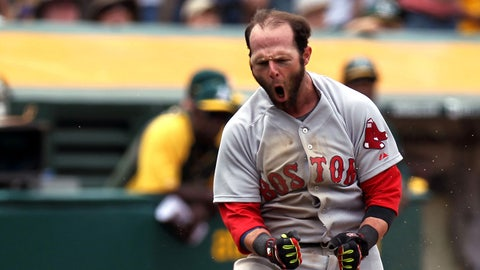 Jun 21, 2014; Oakland, CA, USA; Boston Red Sox second baseman Dustin Pedroia (15) scores on a wild pitch to tie up the game with the Oakland Athletics 1-1 in the eighth inning at O.co Coliseum. Mandatory Credit: Lance Iversen-USA TODAY Sports