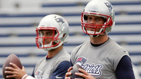 New England Patriots quarterbacks Tom Brady, right, and Jimmy Garoppolo participate in passing drills during NFL football minicamp in Foxborough, Mass., Wednesday, June 18, 2014. (AP Photo/Michael Dwyer)