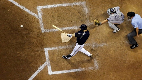 Milwaukee Brewers' Ryan Braun hits a game-winning single during the ninth inning of a baseball game against the Colorado Rockies Friday, June 27, 2014, in Milwaukee. The Brewers won 3-2. (AP Photo/Morry Gash)