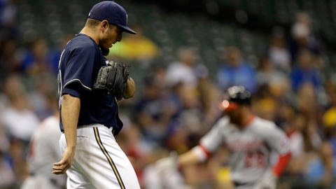 Washington Nationals' Adam Laroche, right, rounds the bases after he hit a three-run home run against the Milwaukee Brewers' Matt Garza, left, during the third inning of a baseball game Monday, June 23, 2014, in Milwaukee. (AP Photo/Jeffrey Phelps)