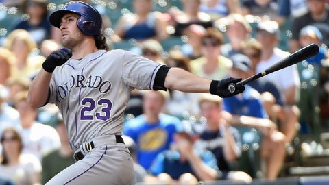 Jun 29, 2014; Milwaukee, WI, USA;  Colorado Rockies third baseman Charlie Culberson (23) hits a two-run home run in the eighth inning against the Milwaukee Brewers at Miller Park. Mandatory Credit: Benny Sieu-USA TODAY Sports