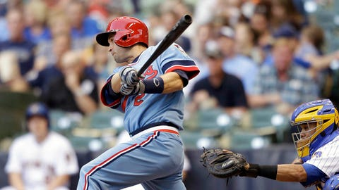 MILWAUKEE, WI - JUNE 03: Brian Dozier #2 of the Minnesota Twins hits a single in the top of the first inning against the Milwaukee Brewers during the interleague game at Miller Park on June 3, 2014 in Milwaukee, Wisconsin. (Photo by Mike McGinnis/Getty Images)