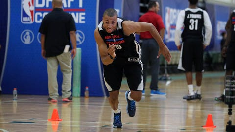 CHICAGO, IL - May 16:  Dante Exum participates in drills during the 2014 Draft Combine on May 16, 2014 at Quest Multisport in Chicago, Illinois. NOTE TO USER:  User expressly acknowledges and agrees that, by downloading and or using this Photograph, user is consenting to the terms and conditions of the Getty Images License Agreement.  Mandatory Copyright Notice:  Copyright 2014 NBAE (Photo by Gary Dineen/NBAE via Getty Images)
