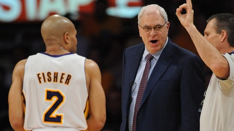 Mar 17, 2011; Los Angeles, CA, USA; Los Angeles Lakers point guard Derek Fisher (2)  and Los Angeles Lakers head coach Phil Jackson (left) react to a foul call during the game against the New Orleans Hornets during the second half of game one of the first round of the 2011 NBA playoffs at the at Staples Center. Hornets won 109-100.   Mandatory Credit: Jayne Kamin-Oncea-USA TODAY Sports