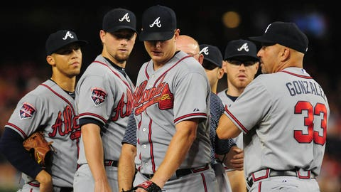 Jun 19, 2014; Washington, DC, USA; Atlanta Braves pitcher Gavin Floyd (center) leaves the game after injuring his elbow in the seventh inning against the Washington Nationals at Nationals Park. Mandatory Credit: Evan Habeeb-USA TODAY Sports