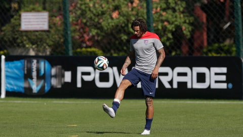 A Powerade banner is seen as United States' Jermaine Jones controls a ball during a training session in Sao Paulo, Brazil, Tuesday, June 24, 2014. The United States will play Germany in group G of the 2014 soccer World Cup on June 26 in Recife, Brazil. (AP Photo/Julio Cortez)