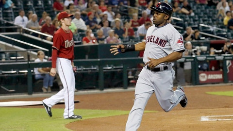 Cleveland Indians' Michael Bourn, right, runs past home plate after scoring as Arizona Diamondbacks' Chase Anderson walks back to the mound during the first inning of a baseball game Wednesday, June 25, 2014, in Phoenix. (AP Photo/Ross D. Franklin)