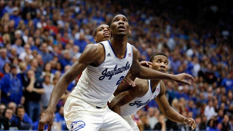 LAWRENCE, KS - FEBRUARY 24:  Joel Embiid #21 and Wayne Selden, Jr. #1 of the Kansas Jayhawks brock out Buddy Hield #24 of the Oklahoma Sooners in the second half at Allen Fieldhouse on February 24, 2014 in Lawrence, Kansas.  Kansas won 83-75. (Photo by Ed Zurga/Getty Images)