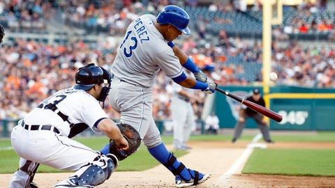 Jun 17, 2014; Detroit, MI, USA; Kansas City Royals catcher Salvador Perez (13) hits an RBI single in the fifth inning against the Detroit Tigers at Comerica Park. Mandatory Credit: Rick Osentoski-USA TODAY Sports