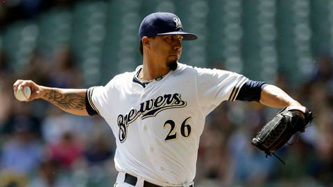 Milwaukee Brewer starting pitcher Kyle Lohse throws to the Chicago Cubs during the first inning of a baseball game on Sunday, June 1, 2014, in Milwaukee. (AP Photo/Jeffrey Phelps)