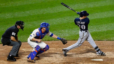NEW YORK, NY - JUNE 12:  Jonathan Lucroy #20 of the Milwaukee Brewers hits a two-run home run in the 13th inning against the New York Mets on June 12, 2014 at Citi Field in the Flushing neighborhood of the Queens borough of New York City. (Photo by Rich Schultz/Getty Images)
