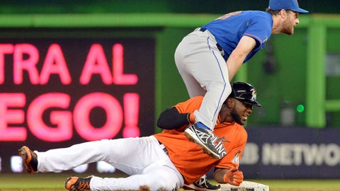 Jun 22, 2014; Miami, FL, USA; Miami Marlins center fielder Marcell Ozuna (13) is forced out by New York Mets second baseman Daniel Murphy (28) during the second inning at Marlins Ballpark. Mandatory Credit: Steve Mitchell-USA TODAY Sports