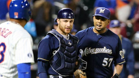 Jun 11, 2014; New York, NY, USA;  Milwaukee Brewers relief pitcher Francisco Rodriguez (57) and catcher Jonathan Lucroy (20) celebrate the win against the New York Mets at Citi Field. Milwaukee Brewers won 3-1.  Mandatory Credit: Anthony Gruppuso-USA TODAY Sports