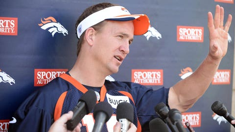 Jun 10, 2014; Denver, CO, USA; Denver Broncos quarterback Peyton Manning (18) speaks to the media following mini camp drills at the Broncos practice facility. Mandatory Credit: Ron Chenoy-USA TODAY Sports