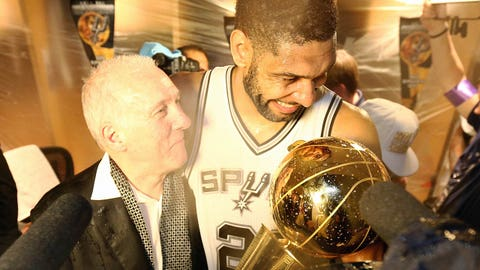 SAN ANTONIO, TX - JUNE 15: Tim Duncan #21 of the San Antonio Spurs and Head Coach Gregg Popovich showered with champagne after winning the 2014 NBA Finals at AT&T Center on June 15, 2014 in San Antonio, Texas. NOTE TO USER: User expressly acknowledges and agrees that, by downloading and/or using this photograph, user is consenting to the terms and conditions of the Getty Images License Agreement.  Mandatory Copyright Notice: Copyright 2014 NBAE (Photo by Nathaniel S. Butler/NBAE via Getty Images)