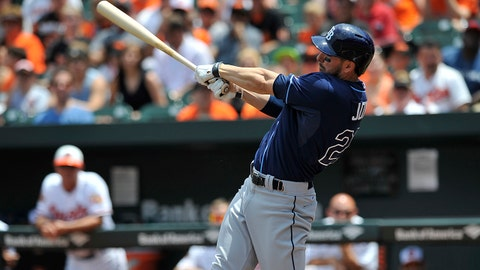Tampa Bay Rays Matt Joyce follows through for a double against the Baltimore Orioles in the first inning of a baseball game, Sunday, June 29, 2014, in Baltimore.(AP Photo/Gail Burton)