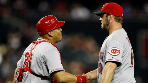 May 31, 2014; Phoenix, AZ, USA; Cincinnati Reds catcher Brayan Pena (29) and pitcher J.J. Hoover (60) celebrate after defeating the Arizona Diamondbacks 5-0 during a baseball game at Chase Field. Mandatory Credit: Rick Scuteri-USA TODAY Sports