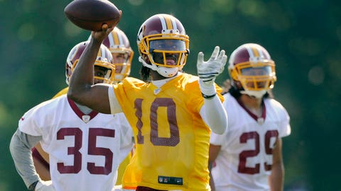 Washington Redskins quarterback Robert Griffin III (10) looks to pass during NFL football minicamp, Tuesday, June 17, 2014, in Ashburn, Va. (AP Photo/Nick Wass)