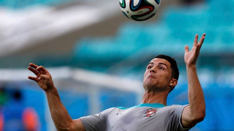 Portugal's Cristiano Ronaldo controls the ball during a training session at the Arena Fonte Nova stadium ahead of their 2014 World Cup against Germany in Salvador, June 15, 2014.    REUTERS/Marcos Brindicci (BRAZIL  - Tags: SPORT SOCCER WORLD CUP)   Picture Supplied by Action Images
