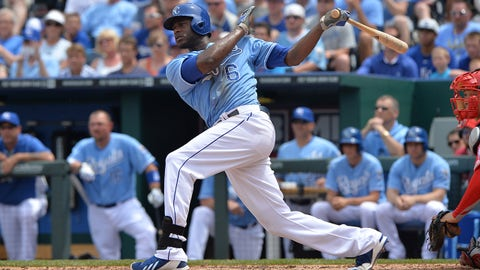 Jun 29, 2014; Kansas City, MO, USA; Kansas City Royals right fielder Lorenzo Cain (6) hits a two run double against the Los Angeles Angels during the fourth inning at Kauffman Stadium. Mandatory Credit: Peter G. Aiken-USA TODAY Sports