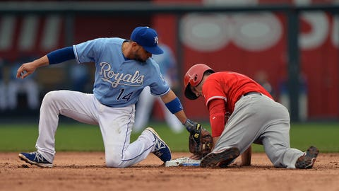 Jun 28, 2014; Kansas City, MO, USA; Kansas City Royals second basemen Omar Infante (14) reaches back late, after Los Angeles Angels base runner David Freese (6) steals second base during the sixth inning at Kauffman Stadium. Mandatory Credit: Peter G. Aiken-USA TODAY Sports