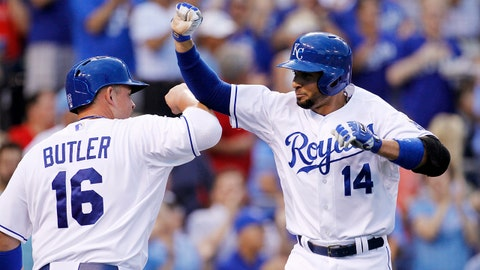 Kansas City Royals' Omar Infante (14) celebrates with Billy Butler (16) after hitting a grand slam home run in the third inning of a baseball game against the Los Angeles Angels at Kauffman Stadium in Kansas City, Mo., Friday, June 27, 2014.  (AP Photo/Colin E. Braley)