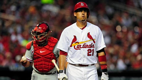 Jun 19, 2014; St. Louis, MO, USA; St. Louis Cardinals right fielder Allen Craig (21) walks back to the dugout after striking out during the fourth inning against the Philadelphia Phillies at Busch Stadium. The Phillies defeated the Cardinals 4-1. Mandatory Credit: Jeff Curry-USA TODAY Sports