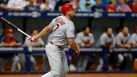 St. Louis Cardinals' Matt Holliday follows through on his solo home run during the sixth inning of a baseball game against the Tampa Bay Rays, Tuesday, June 10, 2014, in St. Petersburg, Fla. (AP Photo/Mike Carlson)