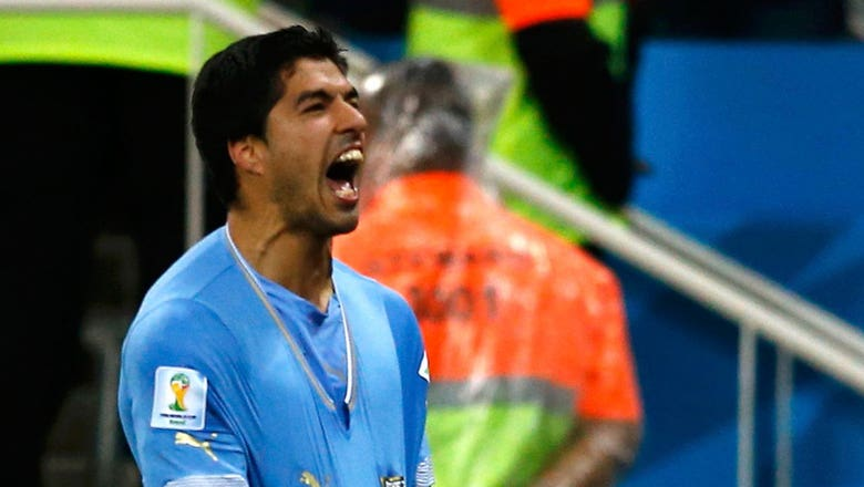 Suarez puts England on brink of group stage exit