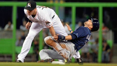 Jun 3, 2014; Miami, FL, USA; Miami Marlins second baseman Ed Lucas (59) tags out Tampa Bay Rays designated hitter David DeJesus (7) at second base during the fourth inning at Marlins Ballpark. Mandatory Credit: Steve Mitchell-USA TODAY Sports
