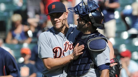Jun 22, 2014; Cleveland, OH, USA; Detroit Tigers relief pitcher Chad Smith (55) hugs Detroit Tigers catcher Alex Avila (13) after the Tigers beat the Cleveland Indians 10-4 at Progressive Field. Mandatory Credit: Ken Blaze-USA TODAY Sports